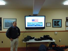Battalion Chief Sly reviews a power point presentation to the VFW officers
