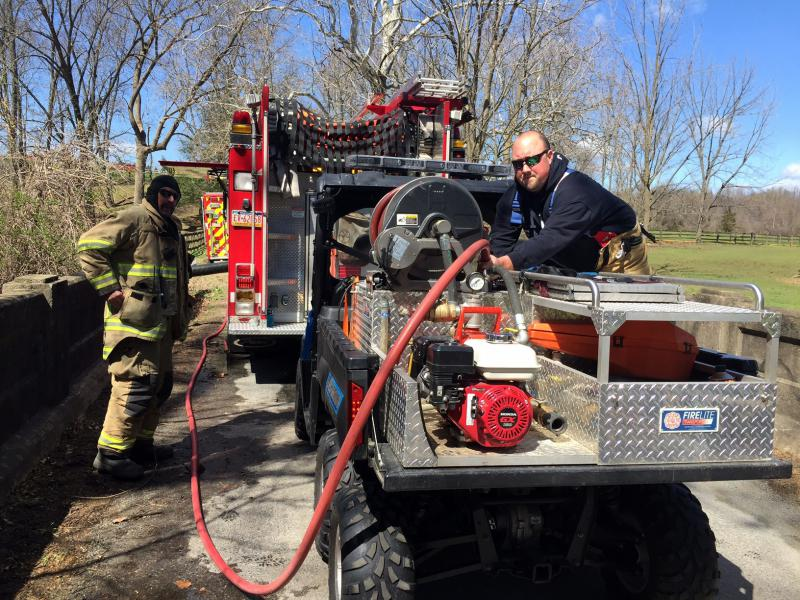 Firefighter Ranck filling the ATV water tank from Union of Oxford Engine 21-1