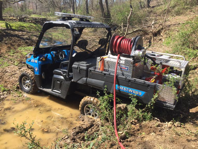 ATV 44 pumping in the wooded and muddy area