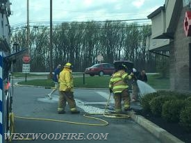 Westwood firefighters operate at the mulch fire inside the Airport Shopping Center.
