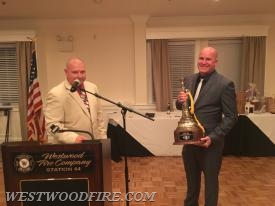 John Sly presented with a golden trumpet award for his dedicated service over the past 20 years.