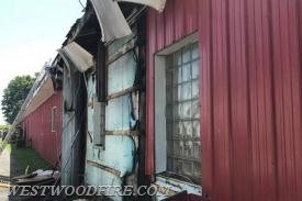 Damage to the structure can be seen, firefighters had to open the siding to expose the fire.