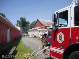 Firefighters arrive with smoke showing to the rear of a business on Strasburg Road.