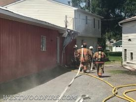 Sadsburyville firefighters stretched additional hose line from Engine 31-1.
