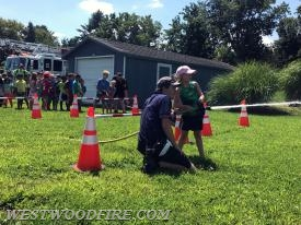 Event attendees had the opportunity to use a fire hose to knock a target off a cone