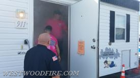 Chief McWilliams uses the smoke house to teach kids how to escape from smoke.