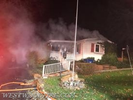 Engine 44-5 arrived on scene with smoke showing and firefighters immediately deployed a hose line to the front door.