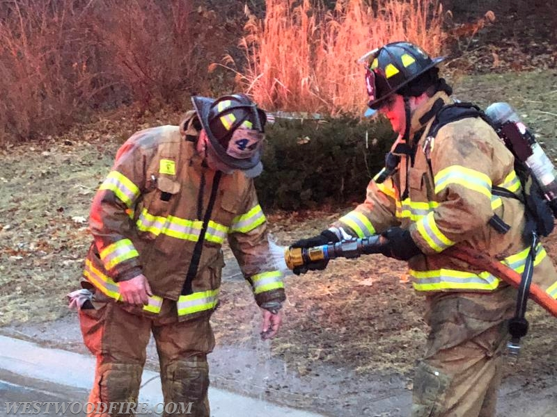 Firefighters decon turnout gear to remove carcinogens from the fire