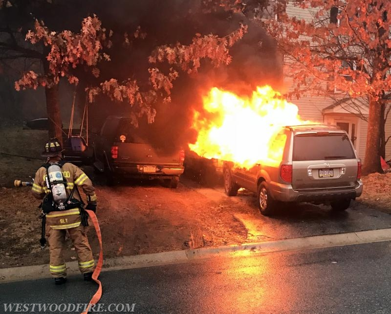 A well-involved vehicle was on fire just feet from a house