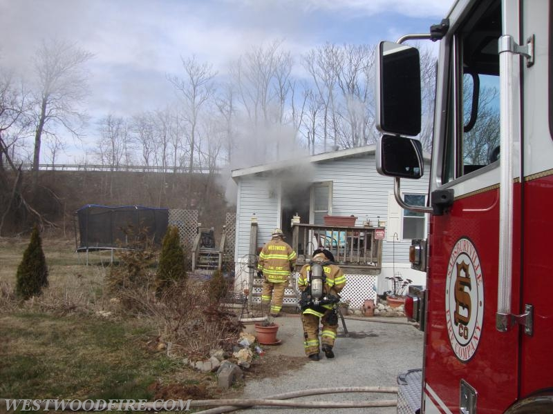 Westwood firefighters arrive and back up Sadsburyville firefighters making a stop on the fire.