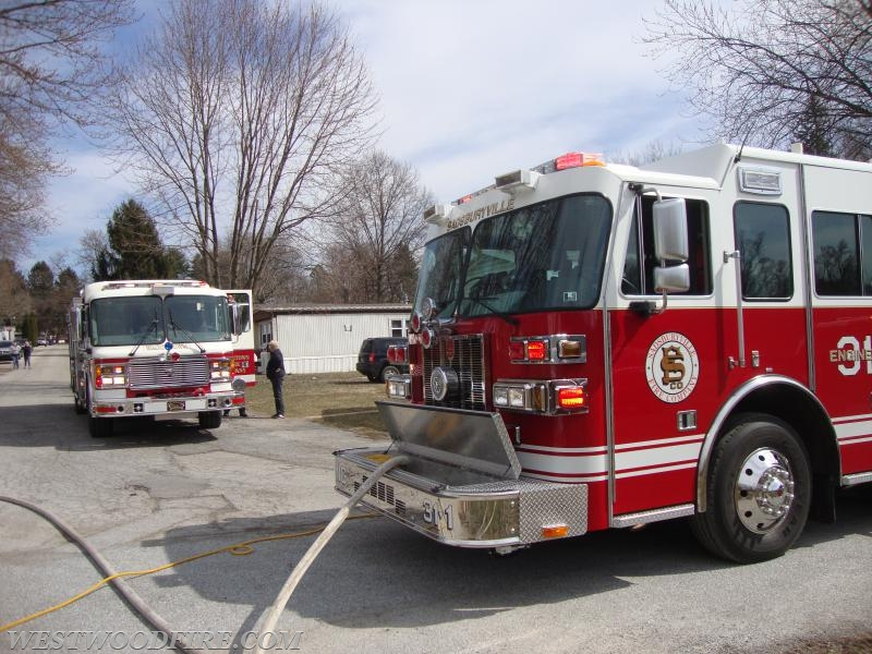 Rescue 35 and Engine 31-1 in front of the fire building.