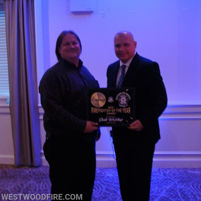 Firefighter Josh Waldrop receives firefighter of the year.