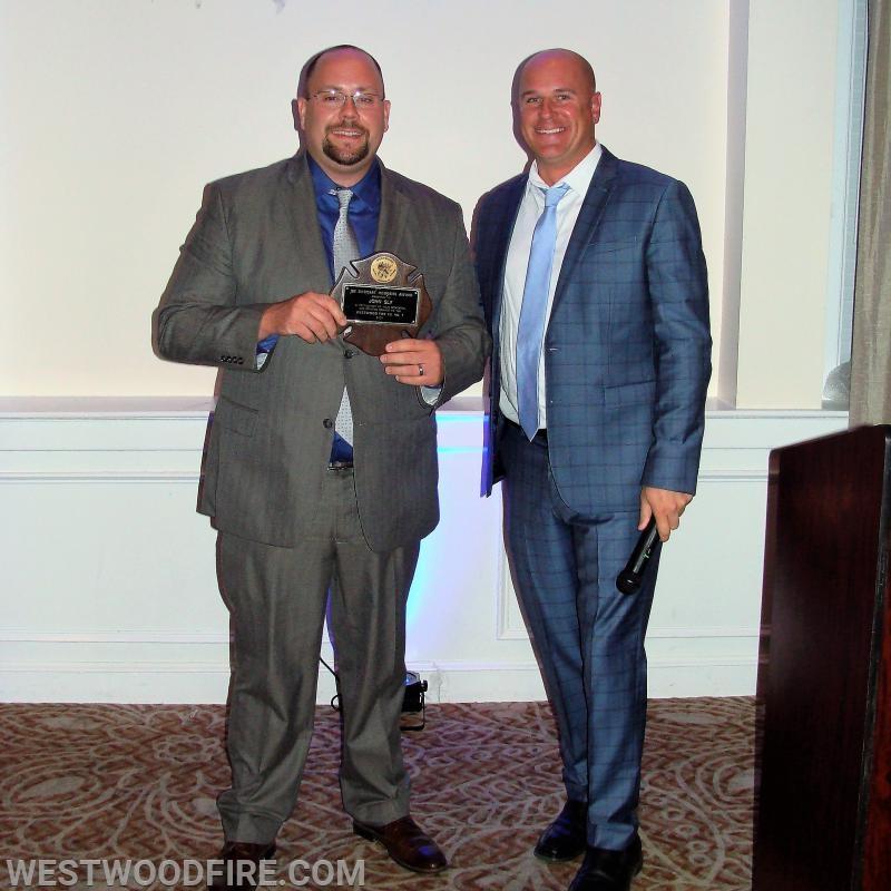 Adam Grossman being presented the Joseph Sweigart Memorial Award by President John Sly.