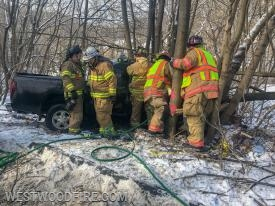 Firefighters get tools set up for extrication.