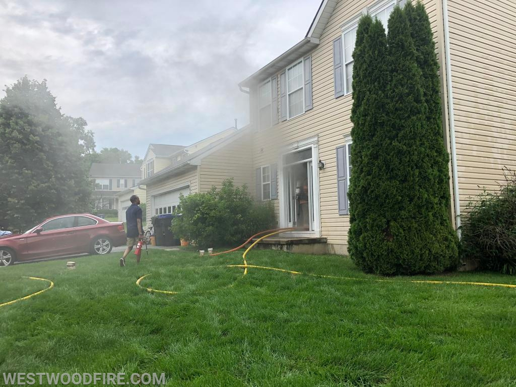Firefighters make entry into the front door to locate the fire.