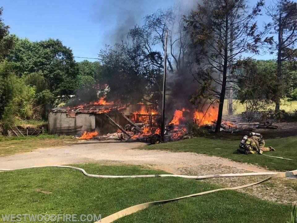 Firefighters arrived to find the structure fully involved with flames.