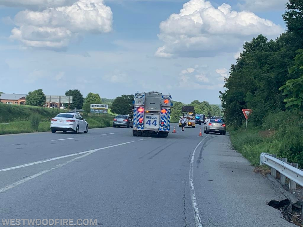 Rescue 44 blocks oncoming traffic to protect the first responders.