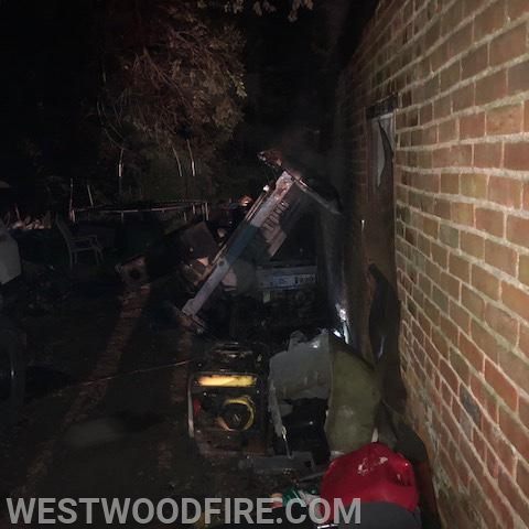 The fire was located on the side of a garage.