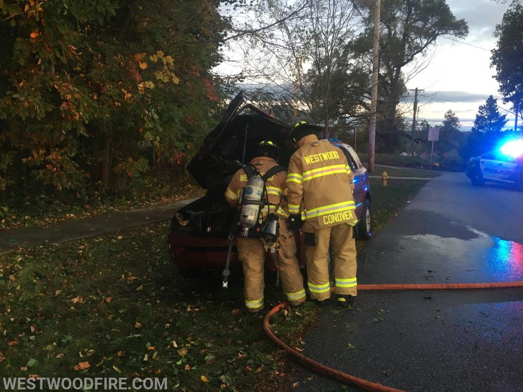 Firefighters Carro and Conover check over the auto for hot spots