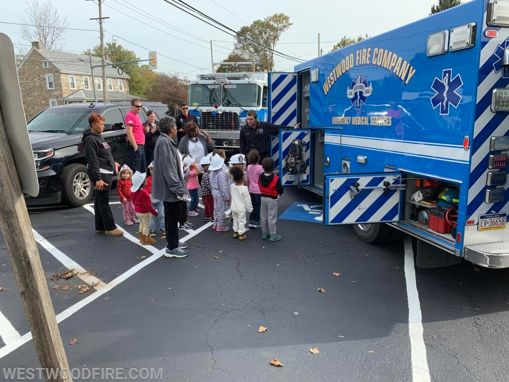 Westwood crew members showing children the equipment on Ambulance 44-1.