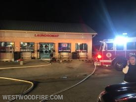 A dryer was on fire inside of the Laundromat.