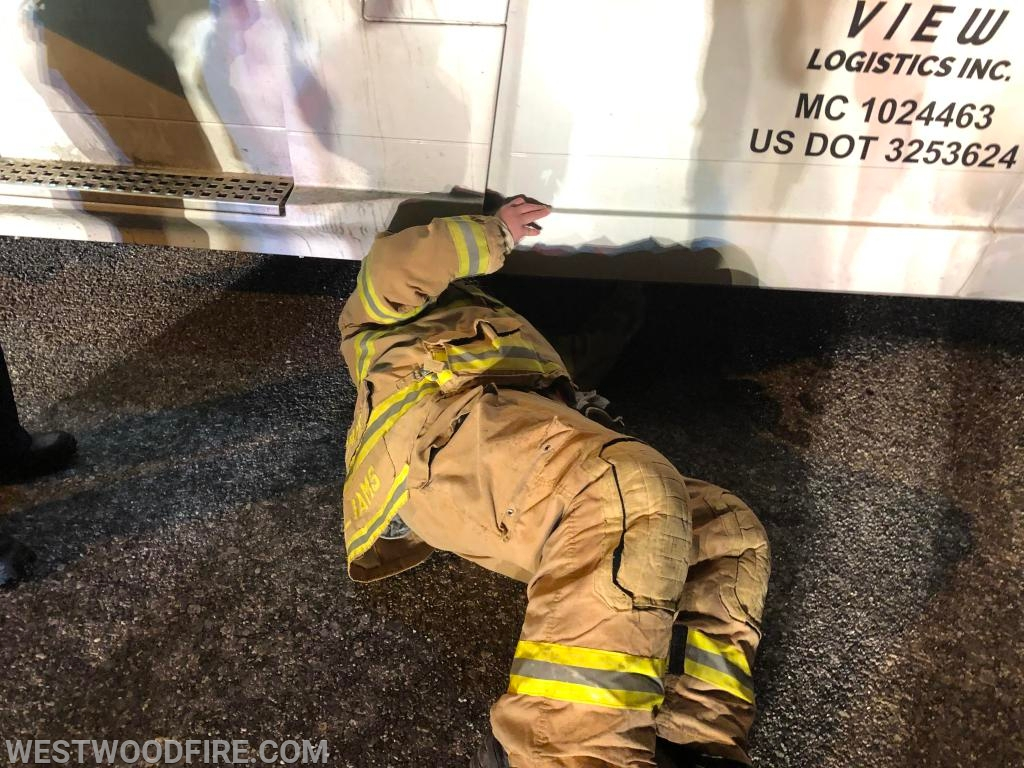 Chief McWilliams plugs the hole in the saddle tank stopping the flow of diesel fuel.