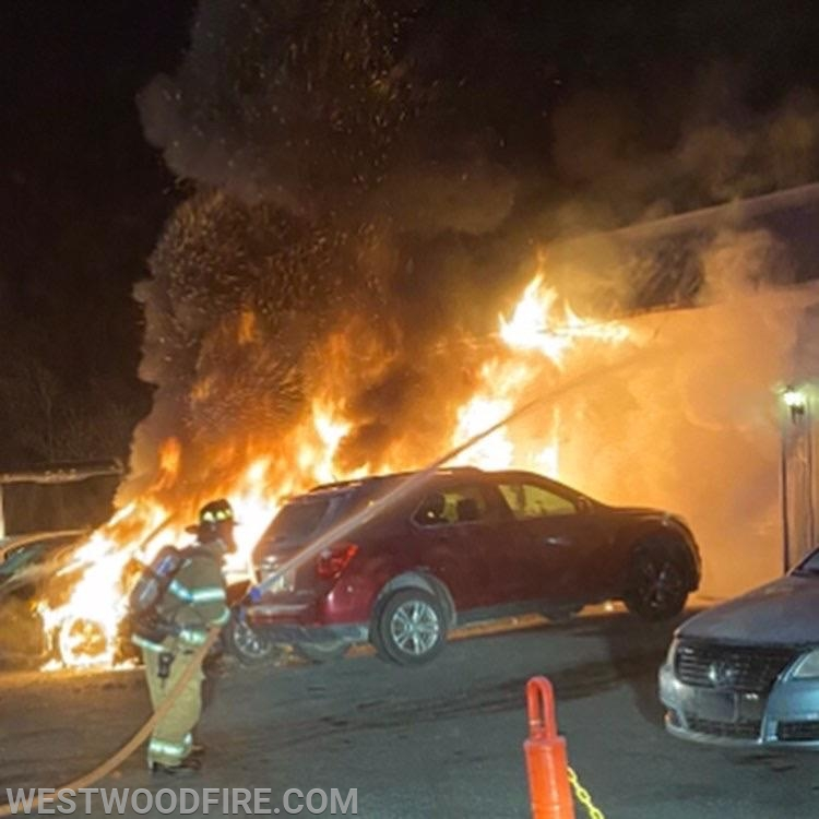 Firefighters arrived to find two automobiles involved with flames and a building beginning to catch on fire.