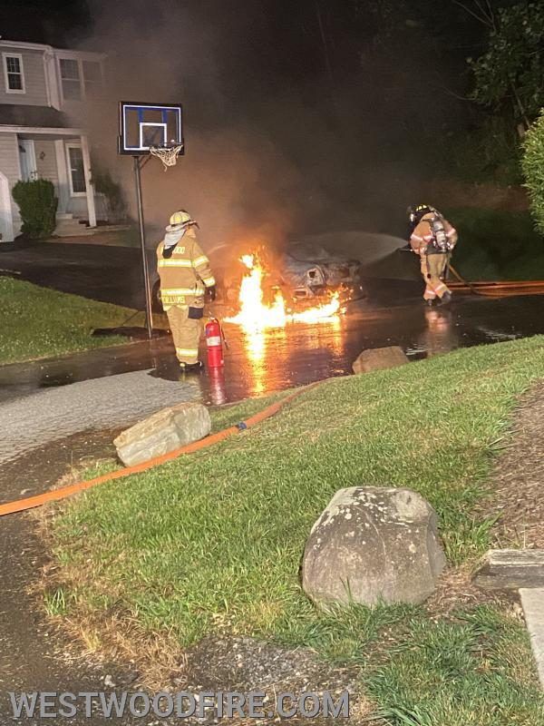 Firefighters extinguish an automobile on fire on Innisbrook Lane in Valley Township.