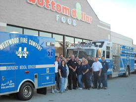 Members of Westwood Fire Company attending the Grand Opening of Bottom Dollar
