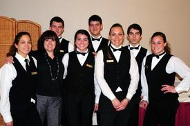 The wonderful staff of the Country Club ready for service